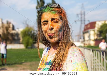 Odessa, Ukraine - August 5, 2017: Portrait Of Beautiful Girl During Holi Celebrations. Fun Girl Teas
