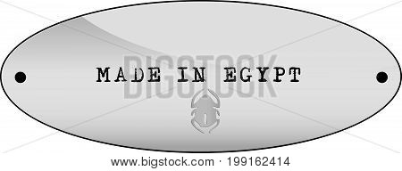 Metal label with text Made in Egypt
