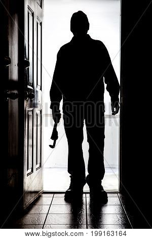 Intruder At Door, In Silhouette With Pipe Wrench