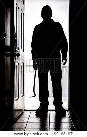 Intruder At Door, In Silhouette With Crowbar.