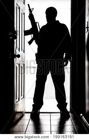 Intruder At Door, In Silhouette With Ar-15 Style Long Gun