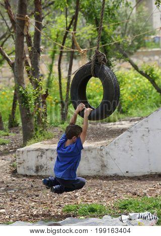 Children ride on impromptu swings