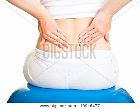 Pregnant woman excercising with ball