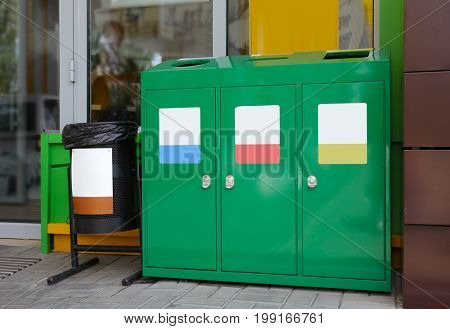 Recycling bins for different types of garbage outdoors. Environmental protection concept