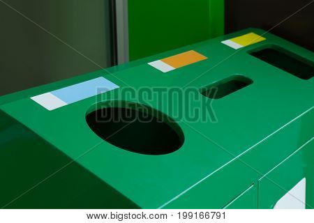 Recycling bins for different types of garbage, closeup. Environmental protection concept
