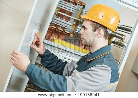 Electrician with electric scheme project