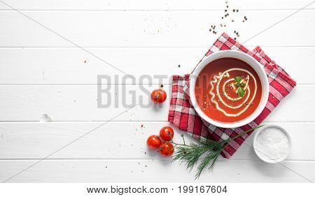 Tomato soup with dill, space for text, topview