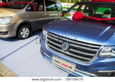 Dongguan, Guangdong, China - August 7, 2017: Dongfeng Chinese automobiles on display at Dongguan car exhibition awaiting prospective buyers