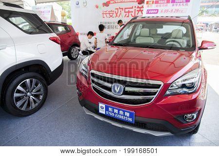 Dongguan, Guangdong, China - August 7, 2017: New Changan Chinese automobiles on display at Dongguan car exhibition awaiting prospective buyers