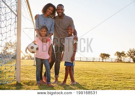 Portrait of a young black family during a football game