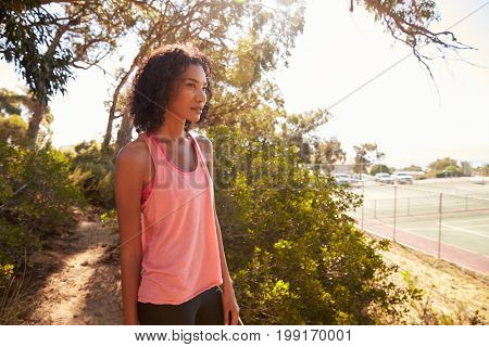 Young black woman taking a break during her run