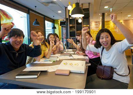BUSAN, SOUTH KOREA - CIRCA MAY, 2017: people at McDonald's restaurant. McDonald's is an American hamburger and fast food restaurant chain.