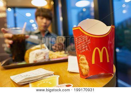 BUSAN, SOUTH KOREA - CIRCA MAY, 2017: close up shot of empty french fries box at McDonald's. McDonald's is an American hamburger and fast food restaurant chain.
