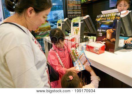 BUSAN, SOUTH KOREA - CIRCA MAY, 2017: people at McDonald's. McDonald's is an American hamburger and fast food restaurant chain.