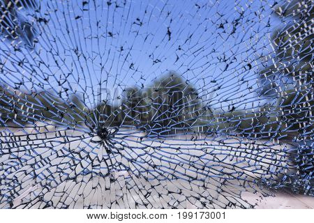 View through smashed car door window from vehicle burglary.