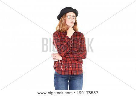 Portrait of teenage girl listening to music on smartphone