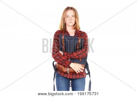 Studio portrait of red-haired female college student with backpack