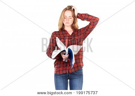 Portrait of beautiful female college student with notebooks against white background