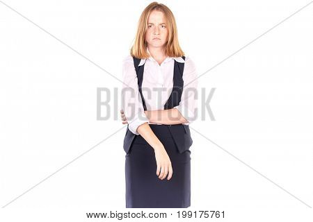 Portrait of beautiful red-haired college student in uniform posing against white background