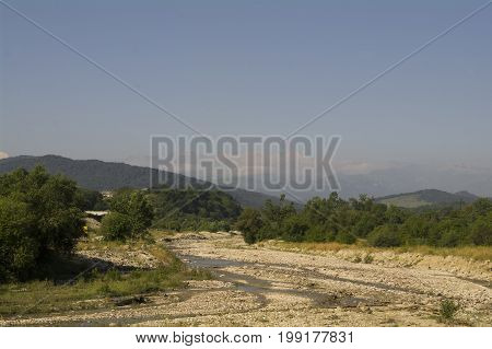 The river bed of the mountain river and foothills