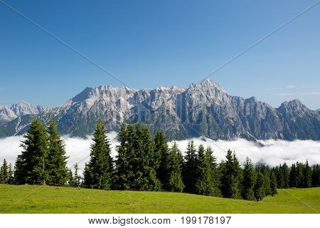 Austrian Alps Salzburg Leogang. Blue Sky Morning Fog Beautiful Scenery Austrian Alps In Summer