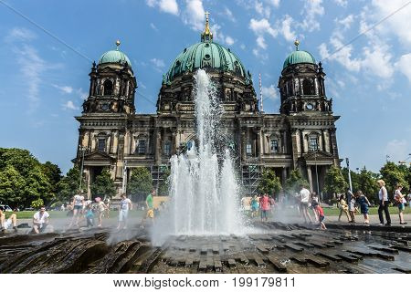 BERLIN - AUGUST 08 2015: Fountain in front of Berlin Cathedral (Berliner Dom).