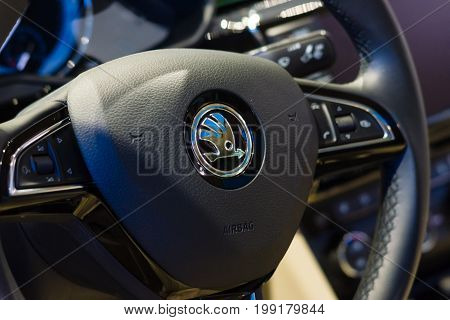 BERLIN - AUGUST 08 2015: Showroom. Steering wheel of a large family car Skoda Superb (Third generation). Produced since 2015.