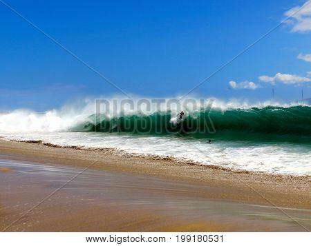 Surfer Riding Wave on Dangerous Hawaiian Shorebreak