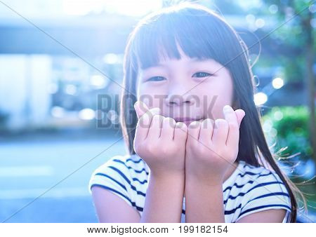Little asian girl show finger with love sign . Love concept .