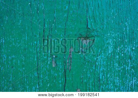 background of old paint on a wooden board