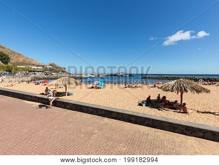 MACHICO MADEIRA PORTUGAL - SEPTEMBER 11 2016: People are resting on a sunny day at the beach in Machico. Madeira Island Portuga