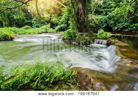 het Sao Noi Waterfall Saraburi Thailand with sun light.