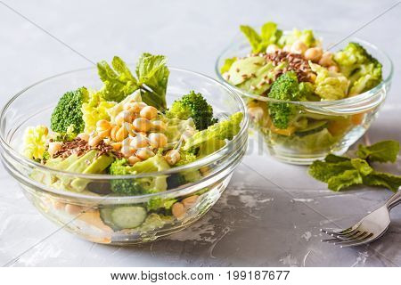Green healthy salad with broccoli cucumber avocado and chickpea sprouts. Love for a healthy vegan food concept.