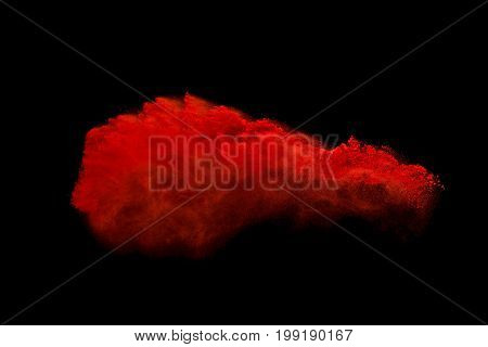 Red colorful powder splash on black background.