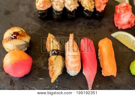 Various fresh and delicios sushi rolls at restaurant