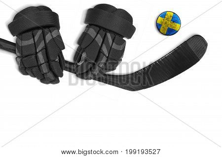 Swedish hockey puck putter and gloves on white background. Concept hockey