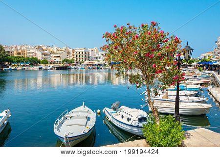 Boats moored on Lake Voulismeni. Agios Nikolaos Crete Island Greece
