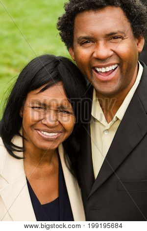 African American mother smiling with her adult son.