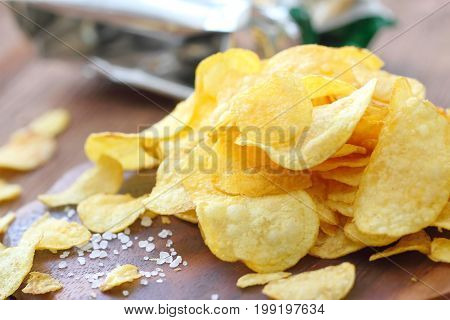 Potato Chips On The Table. Fast Food.