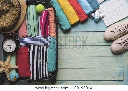concept of travel vacation trip and long weekend planning on wooden background