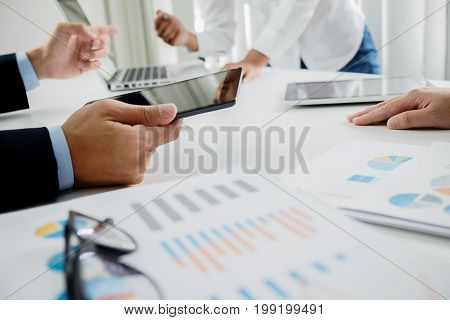 Business Concept. Blurred Business People Discussing The Charts And Graphs Showing The Results Of Th