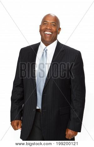 Happy African American businessman isolated on white.