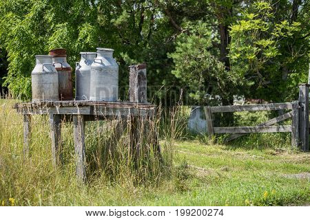 Traditional  churn stand along a countryroad on Swedish Baltic sea island Oland for transport of milk cans to the dairy