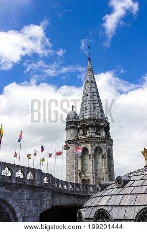Basilica of our Lady of the Rosary and flags of different countries. Lourdes, France