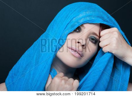 Beautiful Woman Portrait With Blue Veil Over Head