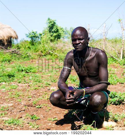 Mago Omo valley Ethiopia- 03 october 2012: Mursi tribe man in national dress