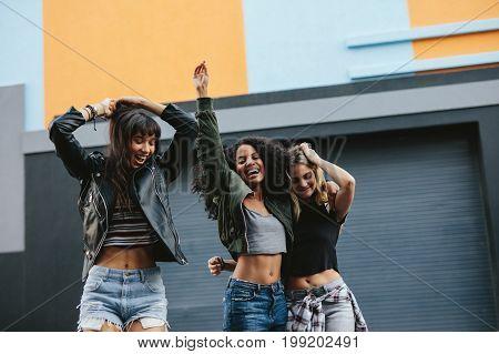Young Women Having Fun On City Street
