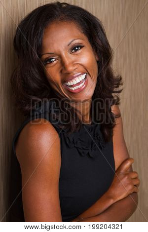 Fashionable beautiful African American mature woman smiling.