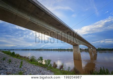 Thai-Lao Bridge at Nong Khai Thailand on blue sky and white cloud background in evening