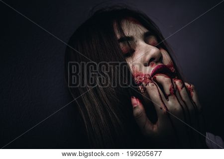 Zombie women death ghost eating with blood darkness background horror halloween festival concept